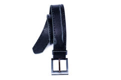 Old leather belt. The curtailed old leather belt with a metal plaque separately Royalty Free Stock Photos