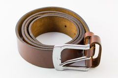 Old leather belt roll. Old leather belt roll on white background stock images