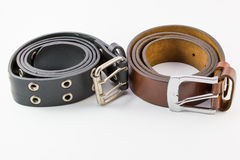 Old leather belt roll on white background. Royalty Free Stock Photo