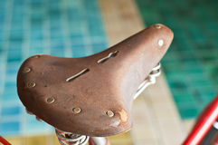 Old leather bicycle seat. Royalty Free Stock Photography