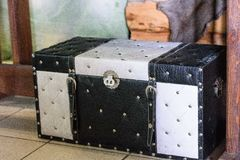 Old leather black with white suitcase. With steel rivets Stock Photography