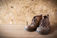 Old leather boot traditional leather style on wood background  i Stock Images