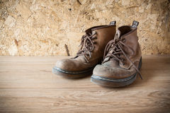 Old leather boot traditional leather style on wood deck in vinta Royalty Free Stock Photos