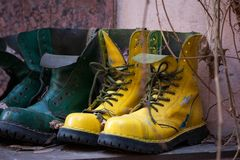 Old leather boots of bright green and yellow colors royalty free stock photos