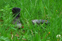 Old leather boots lying in grass Royalty Free Stock Photos