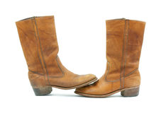 Old leather boots toe to toe. An old pair of leather calf height boots standing toe to toe Royalty Free Stock Photos