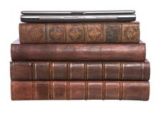 Old leather bound books with a laptop Stock Images