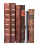Old leather bound books with a laptop Stock Photo