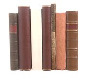 Old leather bound books with one white book Stock Photo