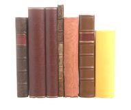 Old leather bound books with one yellow book Royalty Free Stock Images