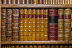 Old leather-bound books on the shelf royalty free stock photo