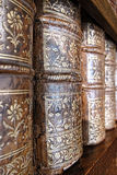 Old Leather Bound Books Spines on Library Shelf. Old and worn leather cover bound books spine with aged gold leaf embossing on an antique wood library bookcase royalty free stock photos