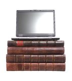 Old Leather Bound Books With A Laptop Royalty Free Stock Photography
