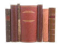 Old Leather Bound Books With One Wide Book Royalty Free Stock Image