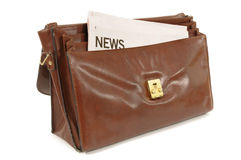 Old brown leather briefcase with news headline isolated on white background Stock Photography