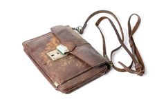 Old leather bag. Old leather brown bag on a white background, isolated Stock Images