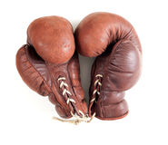 Old leather brown boxing gloves Stock Images