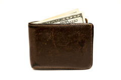 Old leather brown wallet with one  hundred dollars banknote isolated on white background Royalty Free Stock Image