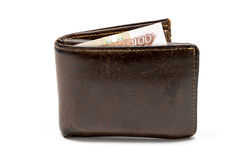 Old leather brown wallet with one hundred rouble banknote isolated on white background Royalty Free Stock Photos