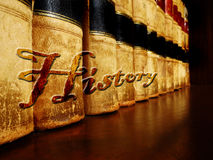 Old Leather History Books on Shelf. Row of old leather books on a shelf with word History cover Royalty Free Stock Image