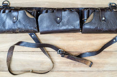Old leather hunting  bandoleer on a wooden table Royalty Free Stock Photo
