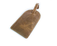 Old leather luggage tag Stock Image