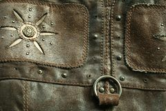 The old leather with the metallic rivets Royalty Free Stock Images