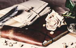 Old leather notebook and dry rose Royalty Free Stock Photography