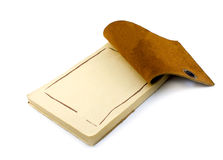 Old leather notepad. Opened leather notepad on white background Stock Photo