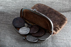 Old leather purse with coins. Old leather purse with silver coins of tsars of House of Romanovs of 18-19 centuries Stock Image