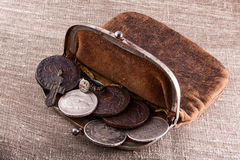 Old leather purse with silver coins Stock Images