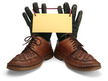 Old leather shoes and gloves. Stock Photos