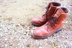 Old leather shoes on the ground royalty free stock photo