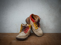 Old leather shoes. With grunge background Royalty Free Stock Photography
