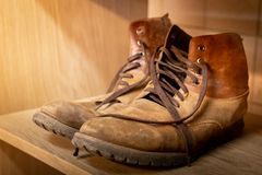 Old, leather shoes. Shabby, brown skin. Tattered shoelaces royalty free stock image