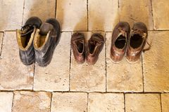 Old leather shoes on stone floor Royalty Free Stock Photo