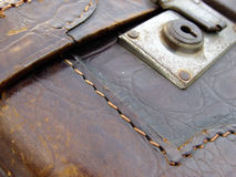 Old leather suitcase. Detail of an old leather suitcase, probably handmade Stock Photo