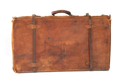 Old leather suitcase. Isolated old and weathered leather suitcase standing royalty free stock photos