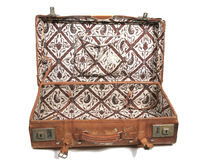 Old leather suitcase. Open old leather suitcase with asian print royalty free stock image