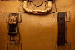 Old leather suitcase. Close up detail of old cracked leather suitcase. Suitable as background image Stock Image