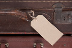 Old leather suitcase with blank label Stock Photography