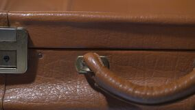 Old leather suitcase closeup, emotional baggage of life experience, memories. Stock footage stock video