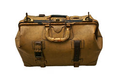 Old leather suitcase isolated. Large old suitcase  with lock made of  tan colored leather, the leather is old and cracked and the straps are broken, isolated on Stock Images