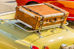 Old leather suitcase on vintage car Stock Photography