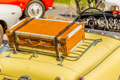 Old leather suitcase on vintage car Royalty Free Stock Photo