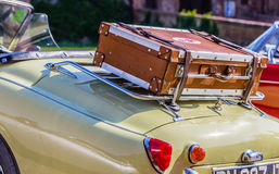 Old leather suitcase on vintage car Royalty Free Stock Image