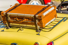 Old leather suitcase on vintage car Stock Images