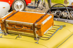 Old leather suitcase on vintage car Stock Photo