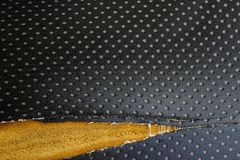 Old leather upholstery Leather upholstery lack.  Stock Photos