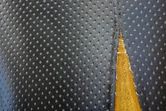 Old leather upholstery Leather upholstery lack.  Stock Image